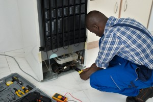 Technician Fixing Refrigerator With Worktool